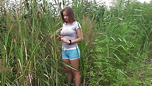 Busty teen Adelle rubbing her pussy in the open outdoors