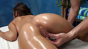 Sensual Latina babe Sara fucks wildly on the massage table